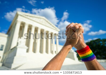 rainbow flag in the clasped hands of a person Stock photo © nito