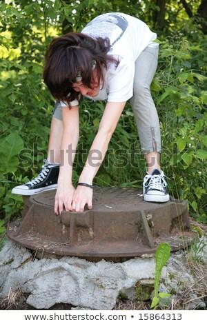 woman tries open iron hatch Stock photo © Paha_L