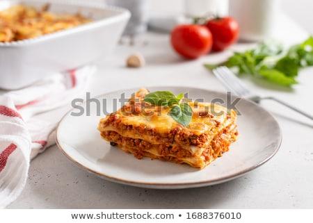 Lasagna étvágygerjesztő darab bazsalikom piros tányér Stock fotó © simply