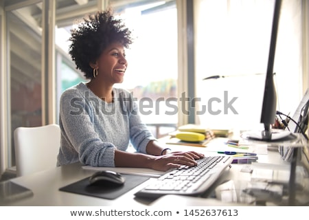 Beautiful african american woman at home with PC Stock photo © darrinhenry