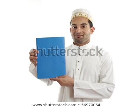 Arab man wearing white robe and topi Stock photo © lovleah