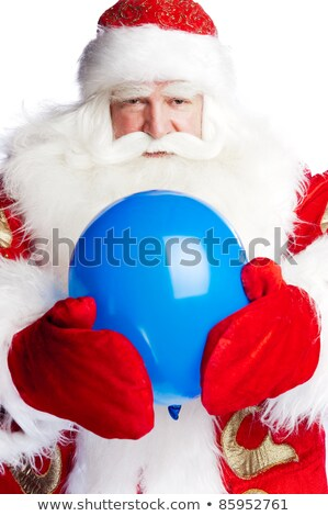 Traditional Santa Claus holding balloons for children. Isolated  stock photo © HASLOO