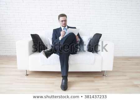 Portrait of an adult business man sitting in the office and sign stock photo © HASLOO