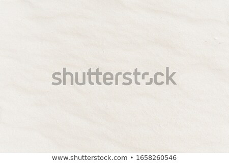 Abstract background of white sand ripples at the beach stock photo © ozaiachin