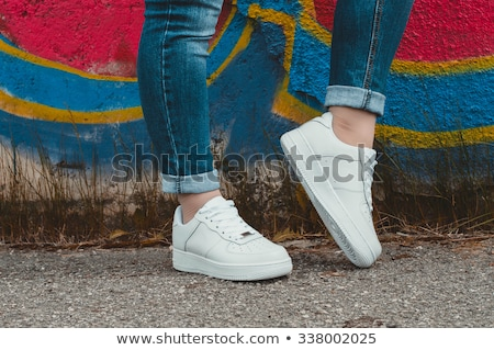 Pink sneakers on girl legs on grass Stock photo © photocreo