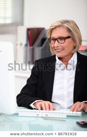 Stock photo: Clerical workers in front of a laptop