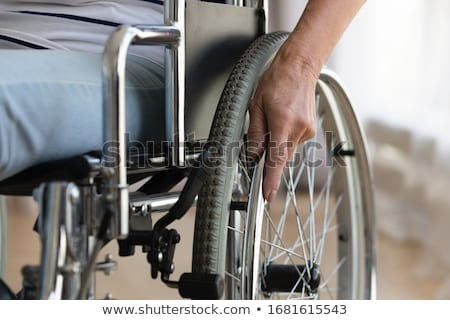woman in wheelchair taken care of stock photo © photography33