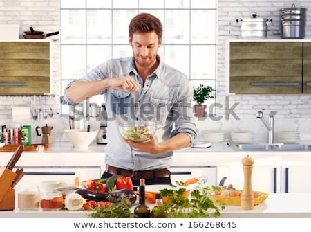 young man cooking in the kitchen stock photo © photography33