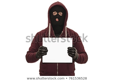 Masked robber wearing hoodie Stock photo © ralanscott