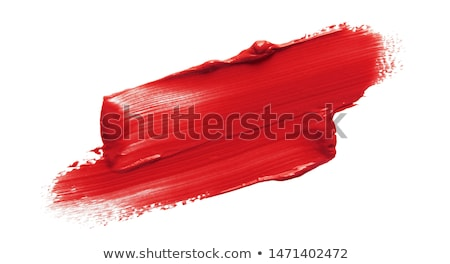 Stock photo: close up of red paint drop on white background