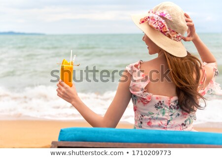Stock photo: young woman enjoying the sea view