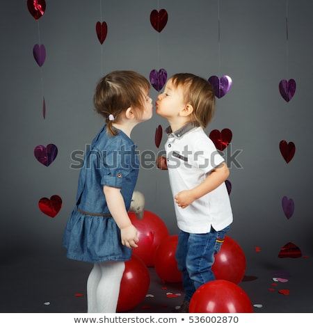 Portrait of romantic couple touching and kissing each other  stock photo © danielkrol