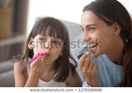 Genç kız makyaj kadın el yüz Stok fotoğraf © privilege