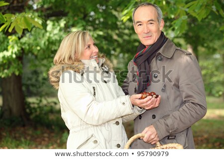 Couple gathering conkers Stock photo © photography33