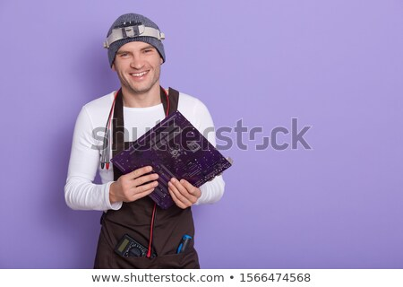 young electrician wearing cap using tester Stock photo © photography33