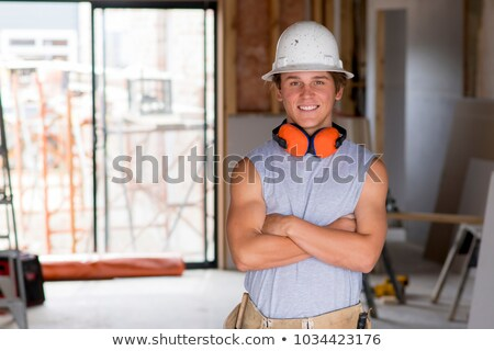 A construction worker and his trainee. Stock photo © photography33