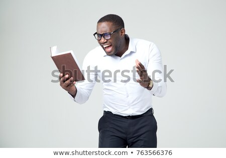 Afro-American businessman reading a report Stock photo © photography33