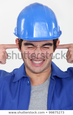 workman putting fingers in his ears to block out noise Stock photo © photography33
