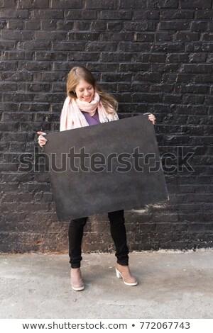 Atraente sorridente menina preto apertado jeans Foto stock © acidgrey
