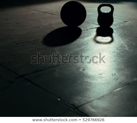 Stock photo: Crossfit Kettlebell weight backlight and shadow