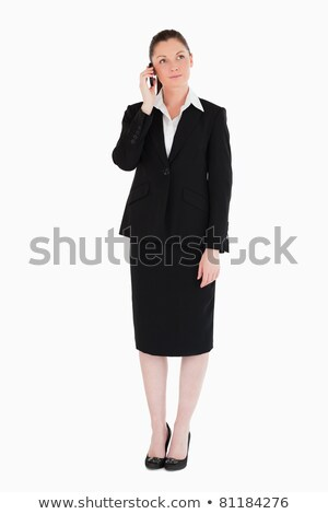 Portrait of a charming woman on the phone while standing against a white background stock photo © wavebreak_media