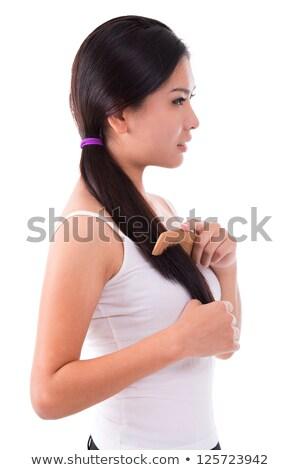 Side View Asian Girl Combing Hair Foto d'archivio © szefei