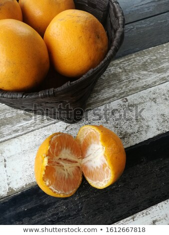Whole tangerine and some segments Stock photo © digitalr