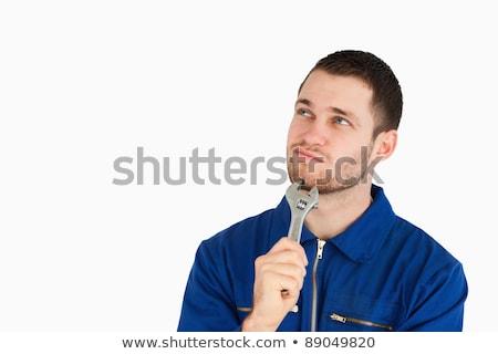 Jóvenes mecánico traje blanco sonrisa construcción Foto stock © wavebreak_media