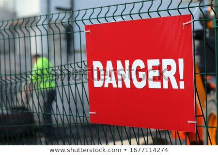 Construction worker behind wire fence Stock photo © photography33