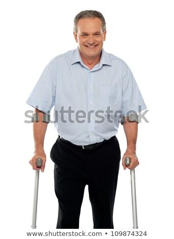 Sebesült férfi mankók izolált fehér gyógyszer Stock fotó © dacasdo