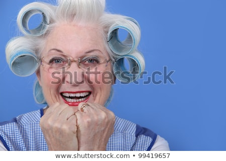 Old woman with her hair in rollers Stock photo © photography33
