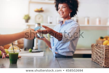 Woman is taking the credit card at cash register Stock photo © wavebreak_media