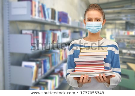Pupil in library stock photo © pressmaster