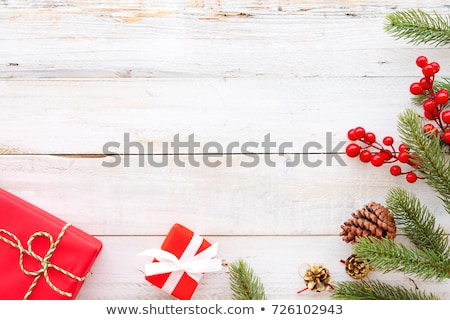 Stock fotó: Christmas Gifts With Pine Holly