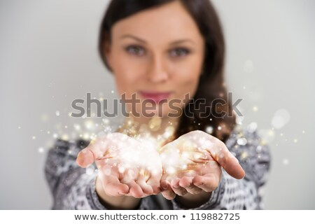 Pretty young brunette woman smiling with hands cupped together,  stock photo © HASLOO