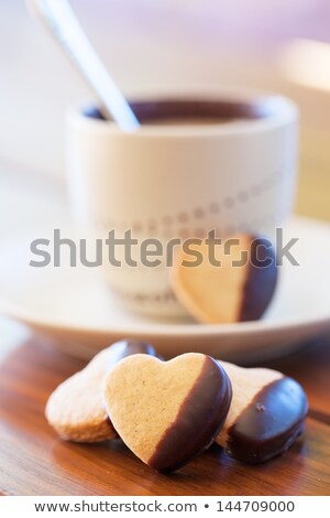 chocolate dipped heart shaped cookies and cup of coffee stock photo © avdveen
