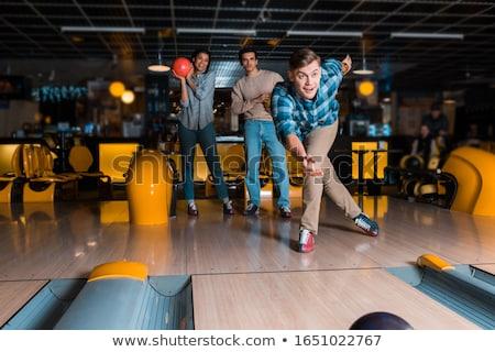 Mosolyog fiatalember játszik bowling golyó sport férfiak Stock fotó © Jasminko