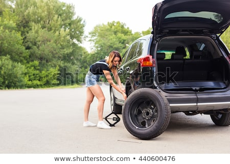Woman changing the wheel Stock photo © Nobilior