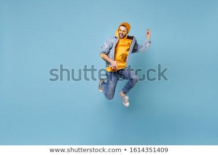 Paixão pose elegante mulher atraente azul Foto stock © ChilliProductions