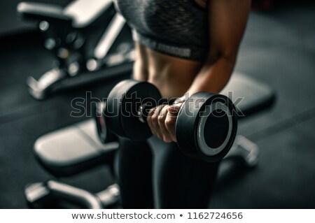man · roeien · machine · gymnasium · gezondheid - stockfoto © hofmeester
