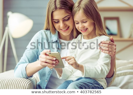 little girl talking on mobile phone stock photo © witthaya