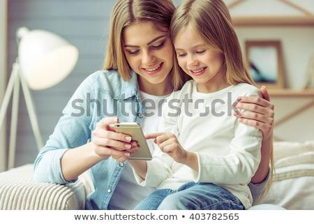 Stock photo: Little girl talking on mobile phone