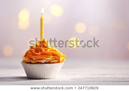 Fancy birthday cupcake with orange candle Stock photo © aladin66