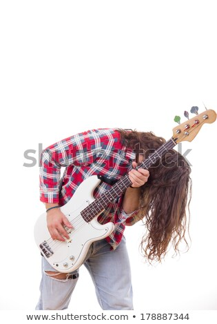 man in shirt with tousled hair playing electric bass guitar Stock photo © feelphotoart