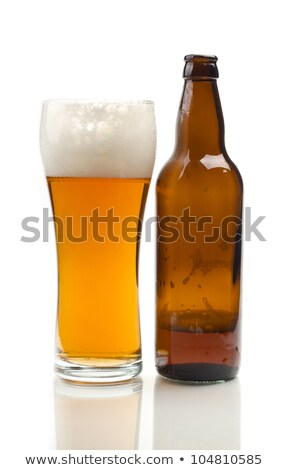 Bottle and glass goblet filled with amber liquid Stock photo © Zerbor