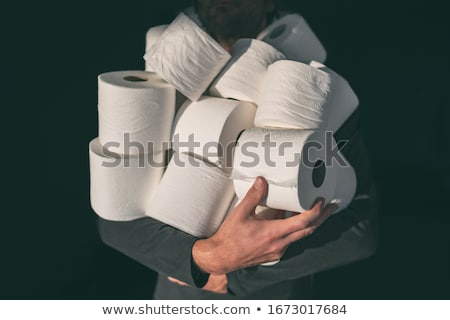 man in toilet holding tissue paper stock photo © andreypopov
