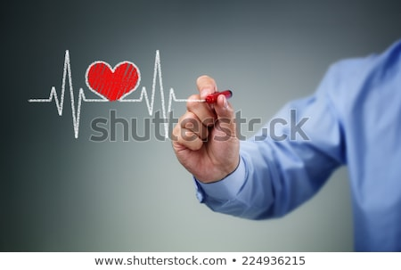 Doctor drawing heart Attack and heart beats cardiogram  Stock photo © Suriyaphoto