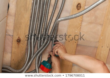 Wire tool on a wooden roof. stock photo © EFischen