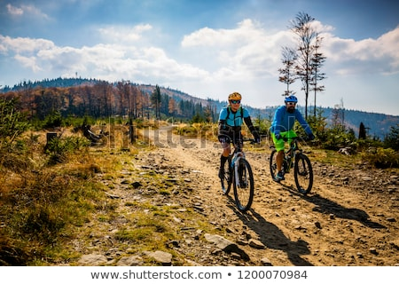 Stock photo: Cyclist Riding the Bike on Beautiful Spring Mountain Trail