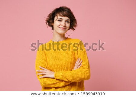 Smiling caucasian woman standing with arms folded Stock photo © deandrobot